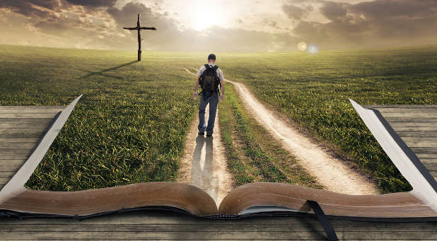 Man walking on a Bible towards a cross